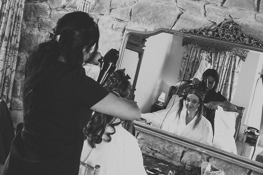 Bride getting her her styled at Newton Hall, Northumberland