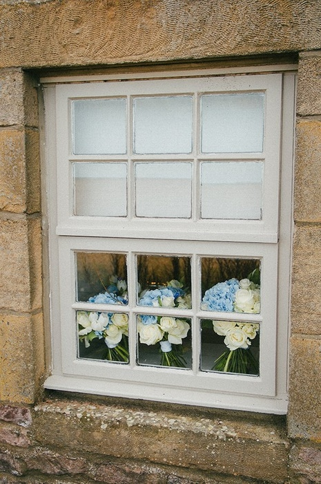 Bouquets in the window of The Courtyard Cottage at Newton Hall, Northumberland