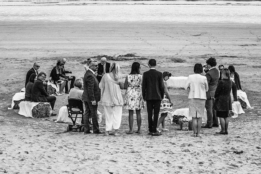 Guests finding straw bail seats on Beadnell Bay in Northumberland