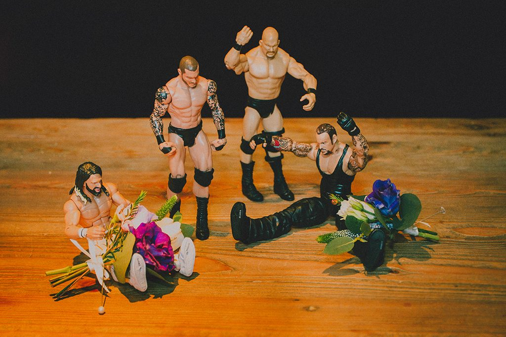 WWE toys putting on their button holes for wedding tips post