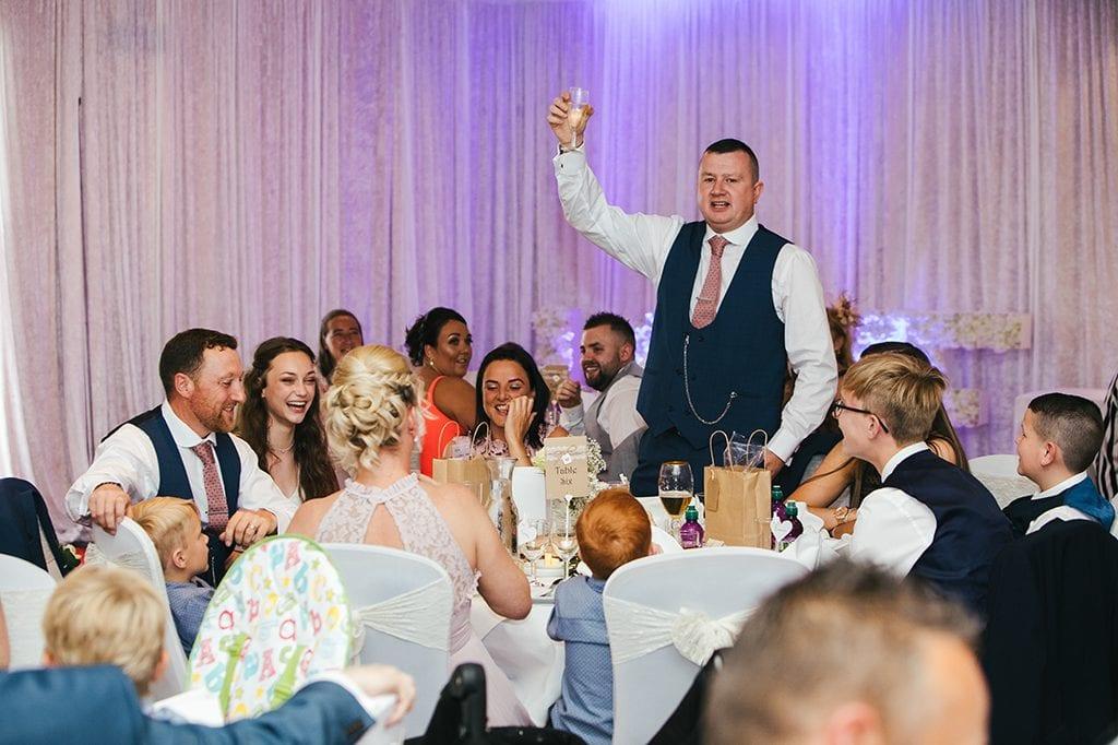 Best man raising a toast