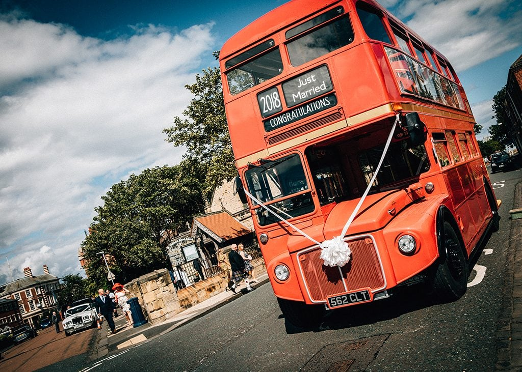 Wedding Tips - A red london bus waiting to take guests to Linden Hall