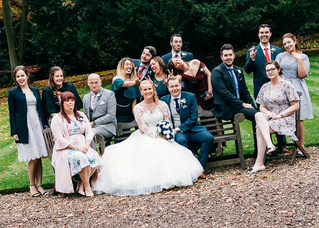Wedding Tips, A group of friends pulling faces with their bride & groom