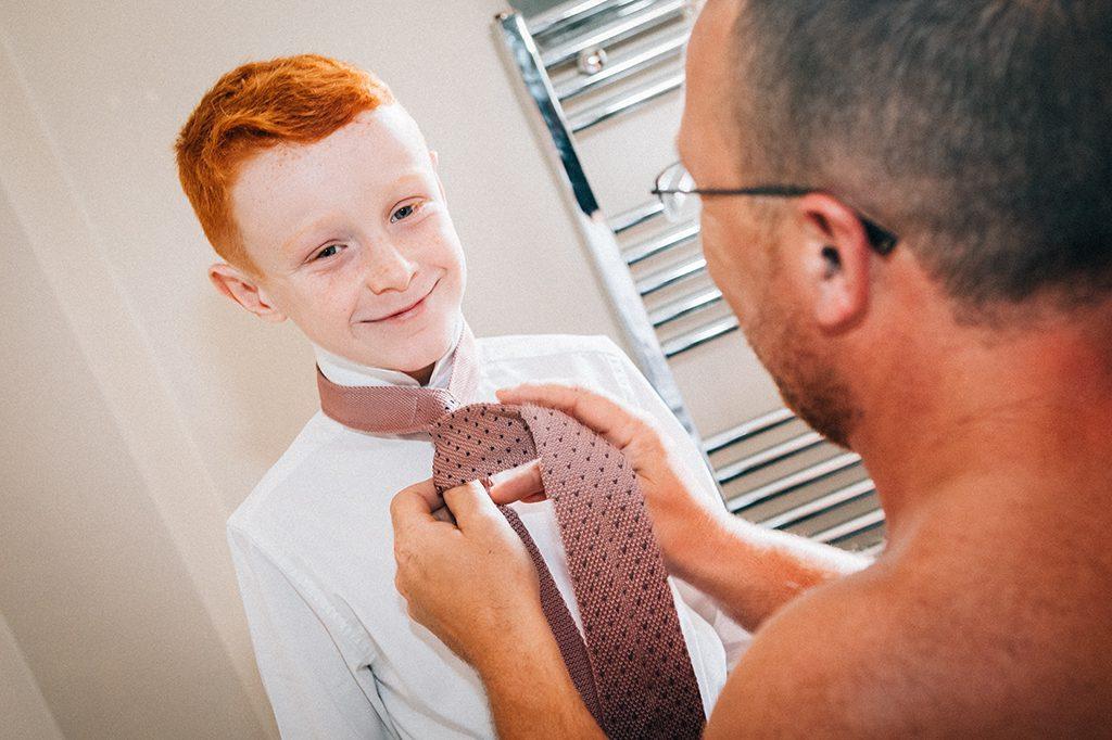 Groom getting his son ready in Blyth