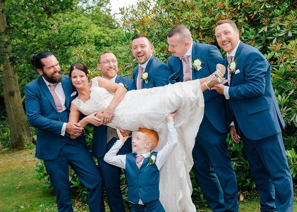 Bride held by Groom & Grooms men Grand Hotel Gosforth Park Newcastle