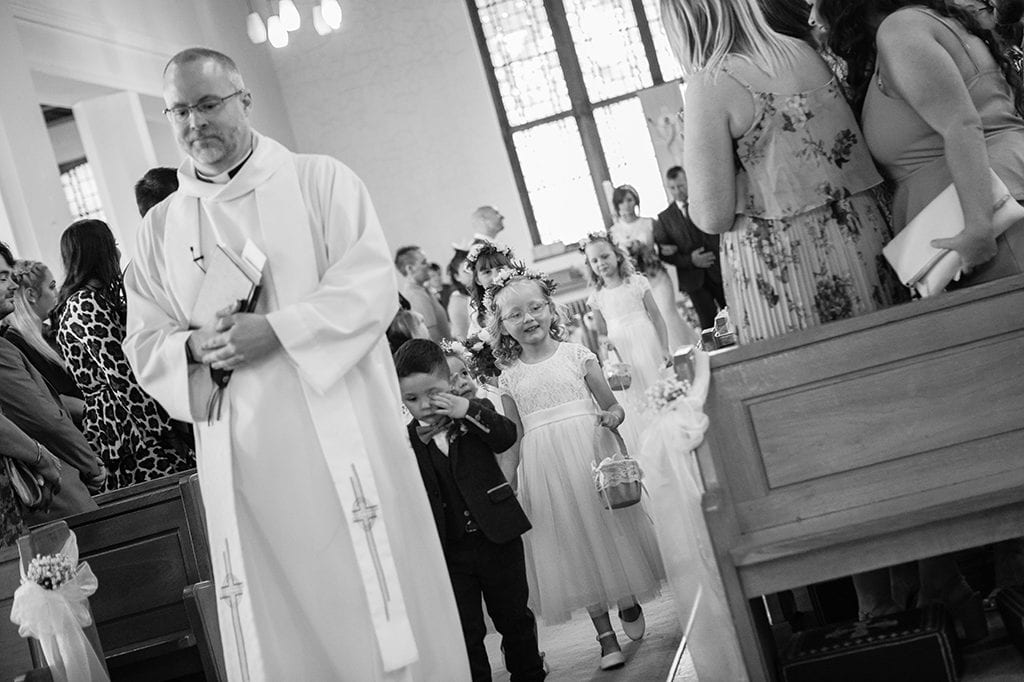 Wedding tips, Bridal Party lost behind a priest, walking down the aisle