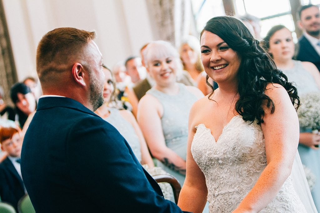 Wedding tips, Bride & Groom Smiling at each other during the service