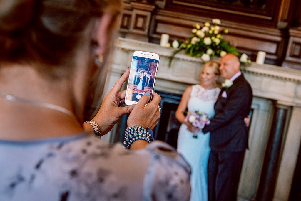 Wedding tips, Someone taking a photo on their phone during the service