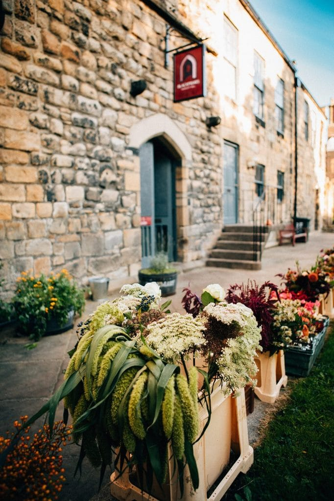 Flowers waiting to be prepared outside of the Banquet Hall at Blackfriars Courtyard