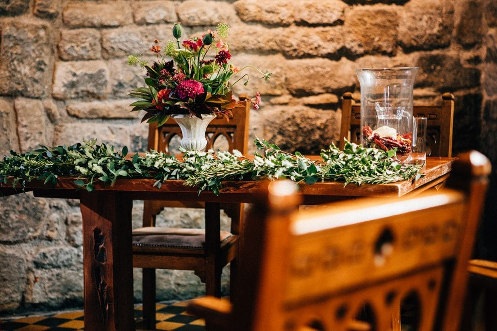 Vases of flowers & foliage on the service tables in the banquet hall of Blackfriars in Newcastle