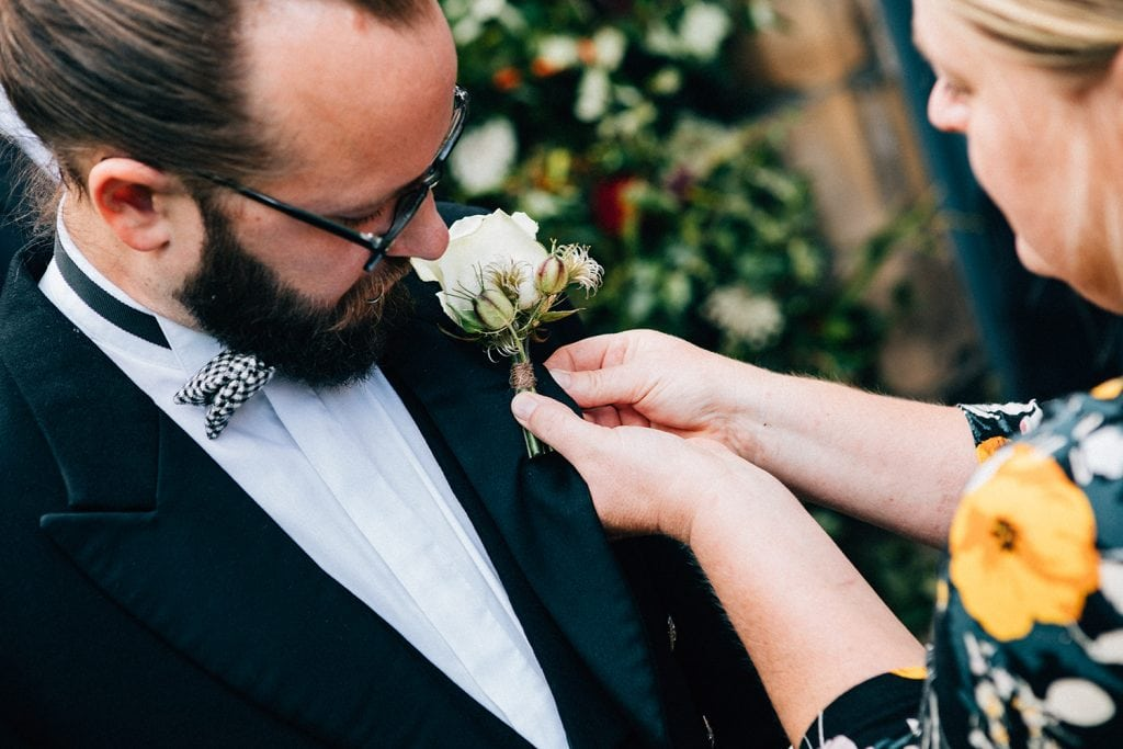 Northumbrian Flowers attaching the grooms buttonhole