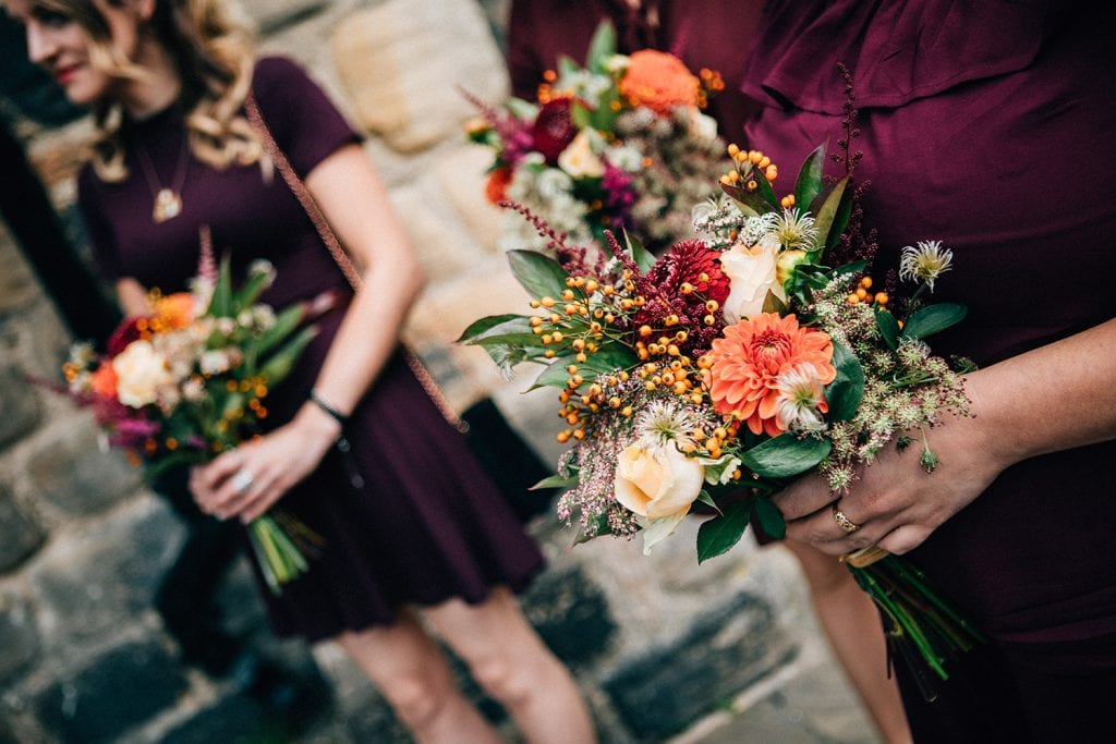 Bridesmaids holding their bouquets outside of Blackfriars in Newcastle