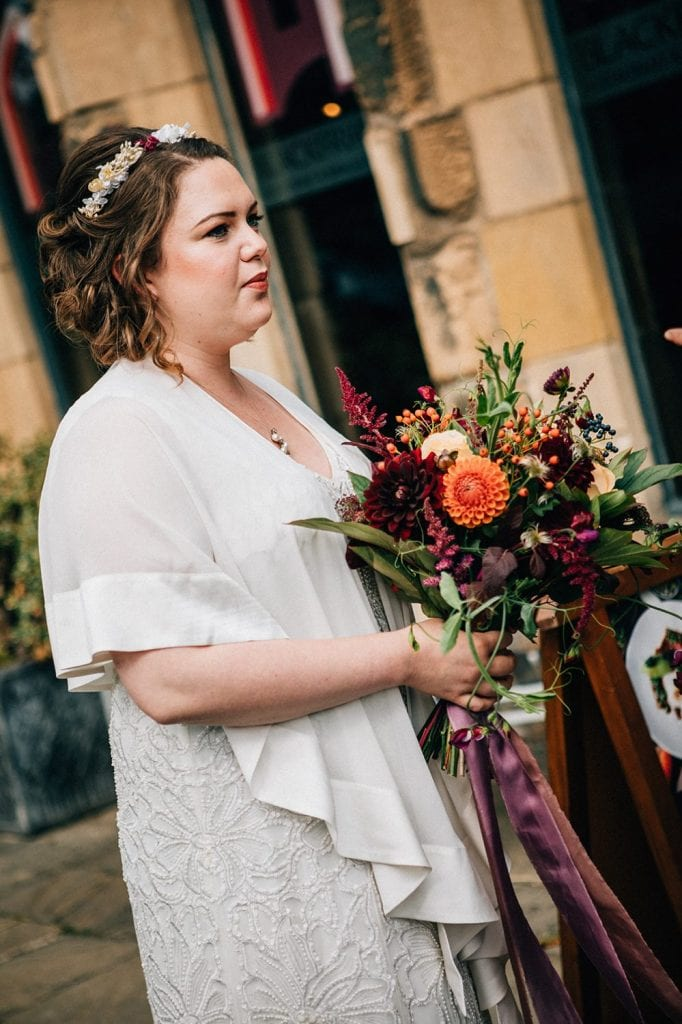 Bride holding a Bouquet from Northumrian Flowers outside of Blackfriars in Newcastle