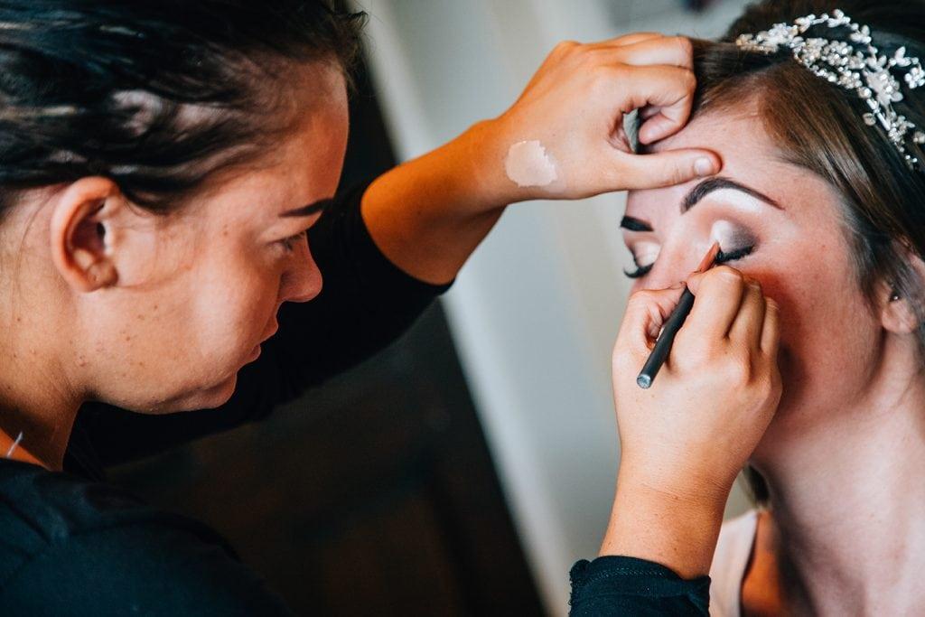 Bride getting makeup applied beforeThe Roker Hotel in Sunderland
