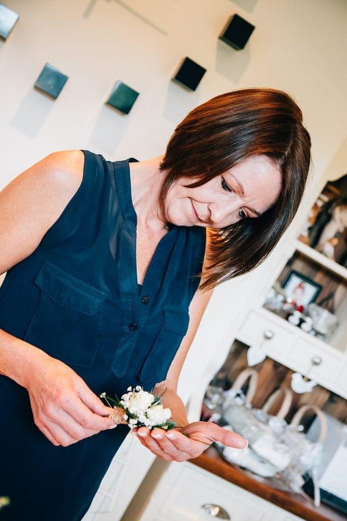 Brides mum orgainising buttonholes before The Roker Hotel in Sunderland