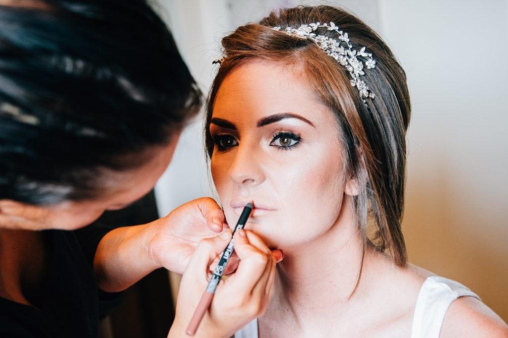 Bride getting lipliner applied beforeThe Roker Hotel in Sunderland