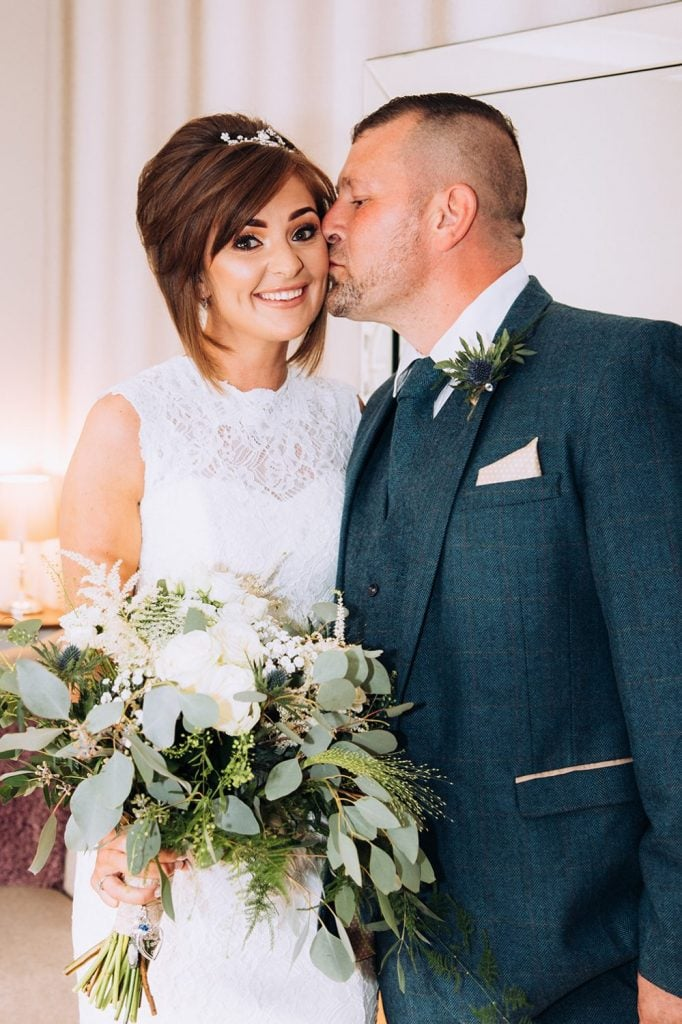 Bride getting a kiss from her father before The Roker Hotel in Sunderland