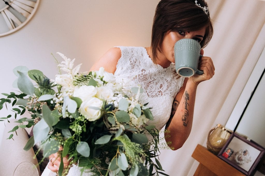 bride finishing her coffee before leaving for the church in sunderland