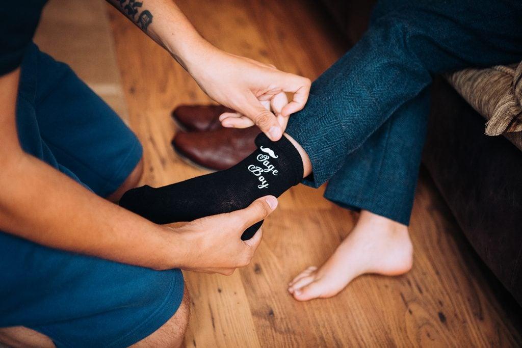 Close up of pageboys personelised socks