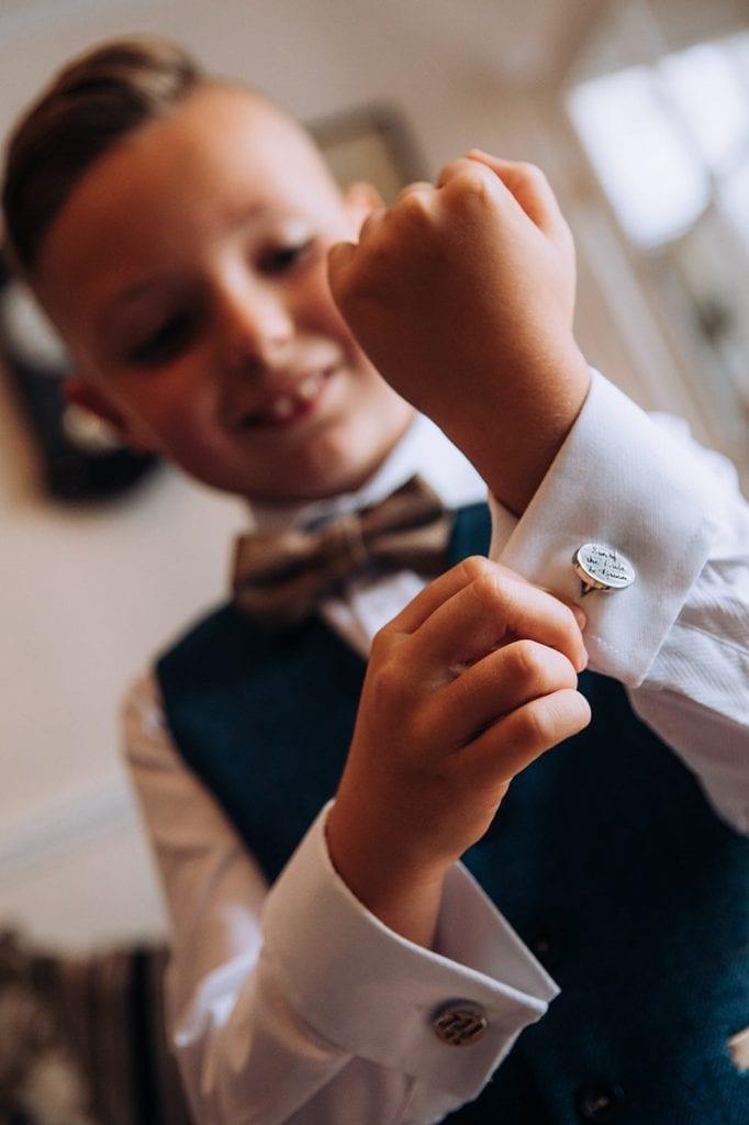 Pageboy showing off his cufflinks
