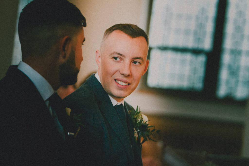 Groom talking to Bestman in St Chad's Church in Sunderland