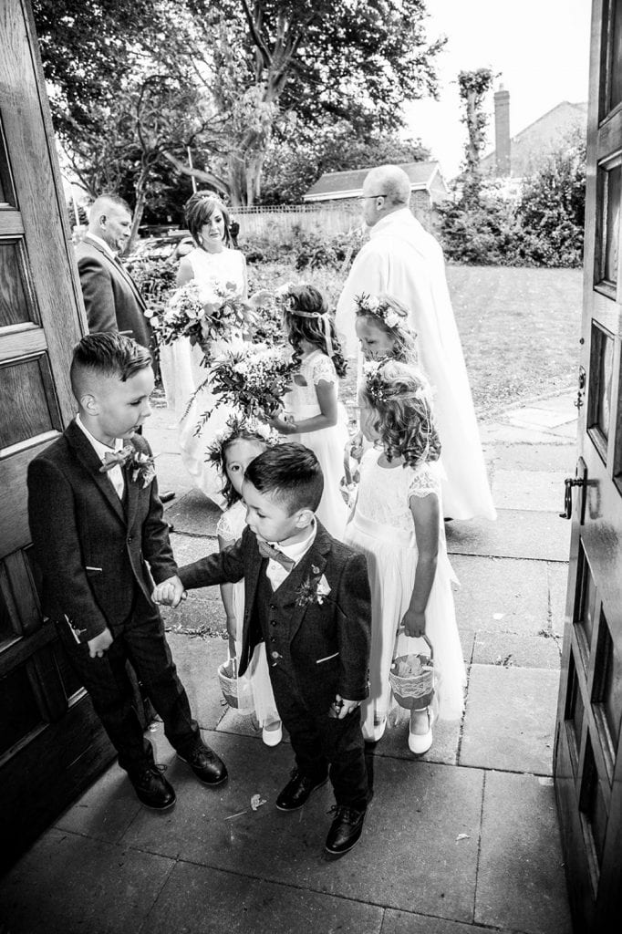 Bridal Party waiting with bride to enter St Chad's Church in Sunderland