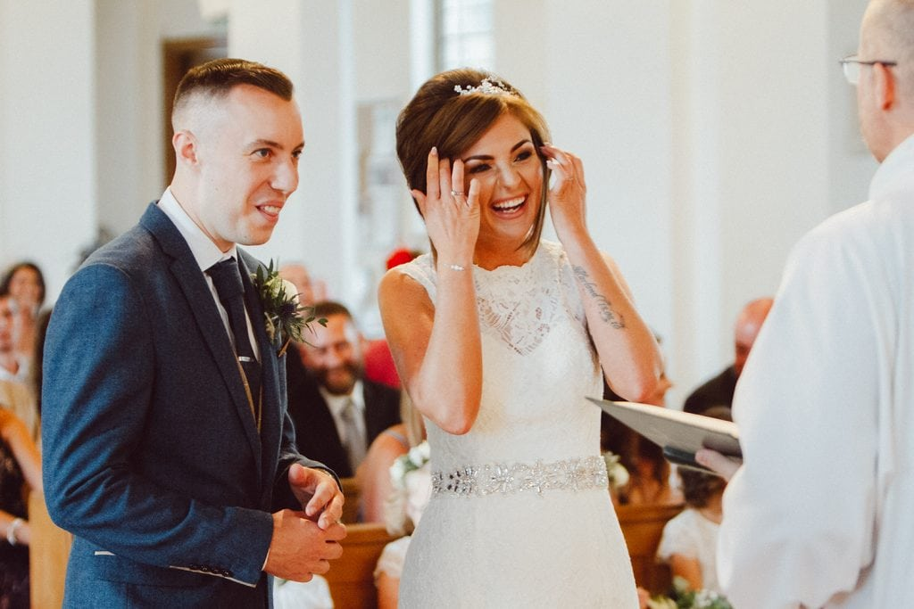 Bride & Groom laughing at the priest St Chad's Church in Sunderland