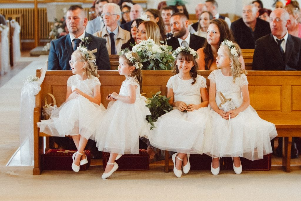 Bridesmaids & flowers girls watching the ceremony in St Chad's Church in Sunderland