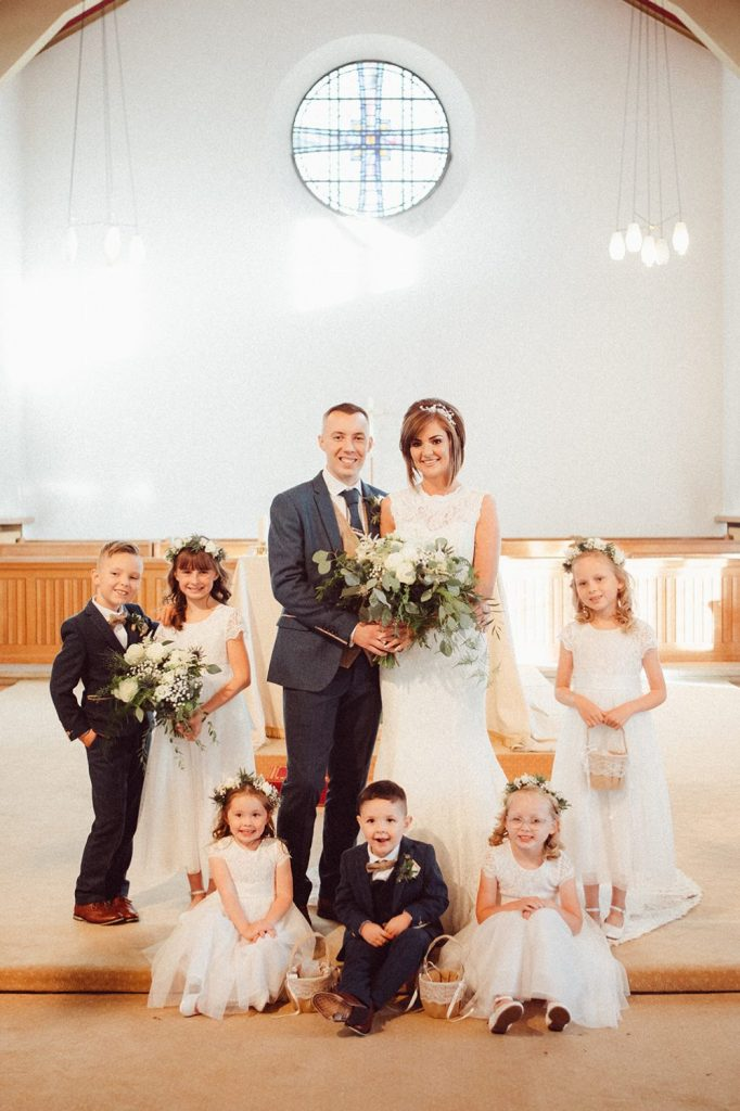Bride & Groom surrounded by the bridal party children St Chad's Church in Sunderland