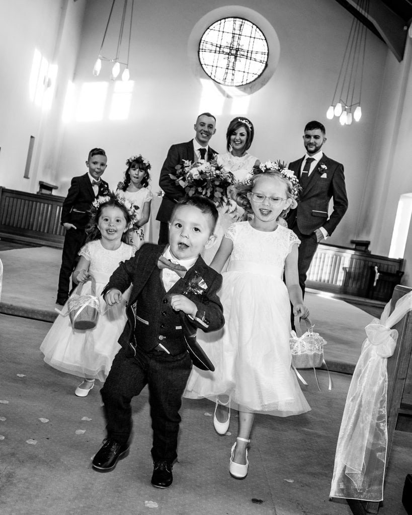 Children running from the alter at St Chad's Church in Sunderland