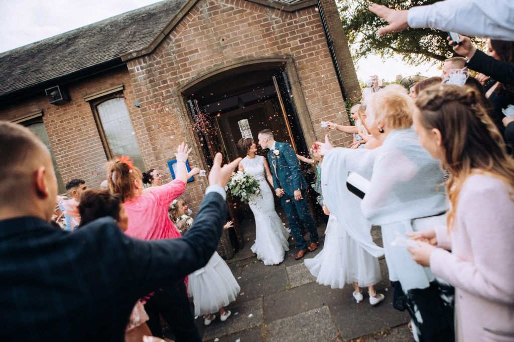 Bride & Groom covered in confetti outside St Chad's Church in Sunderland