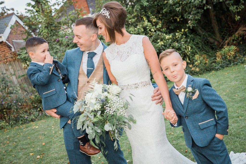 Bride & Groom larking about with their family