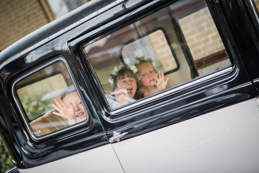 Kids waving from wedding car at The Roker Hotel in Sunderland