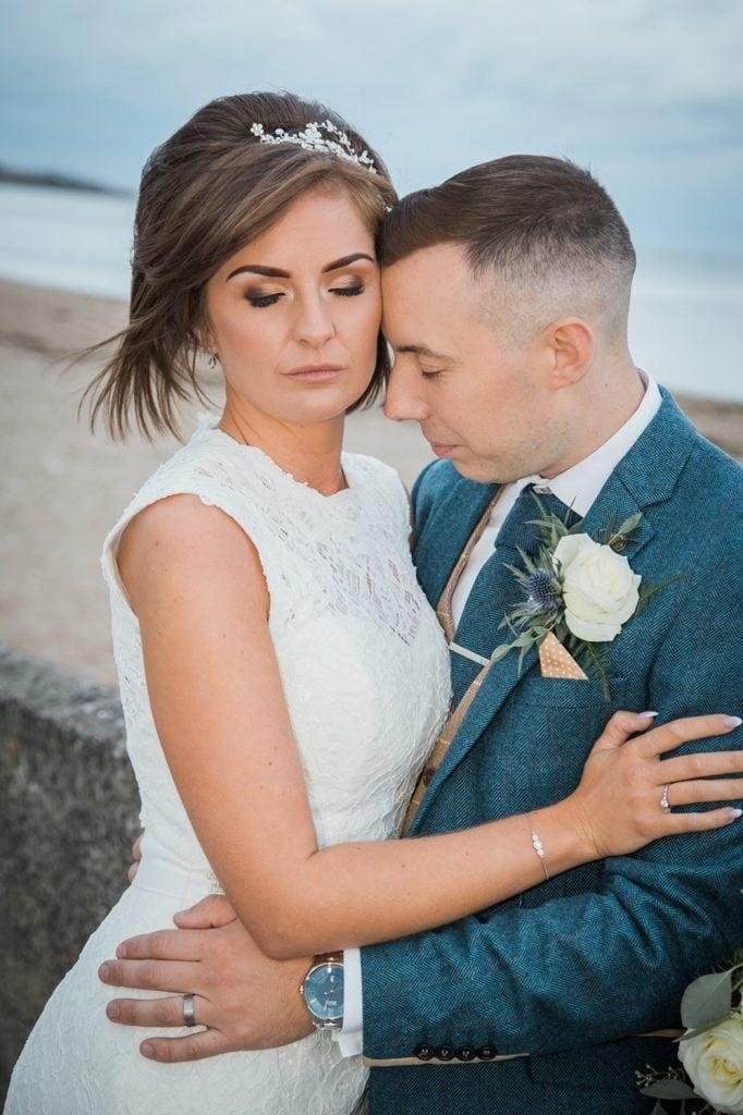 Groom resting his forehead on Bride near Sunderland Beach Front