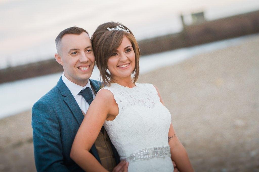 Bride & Groom smiling together on Sunderland Beach Front