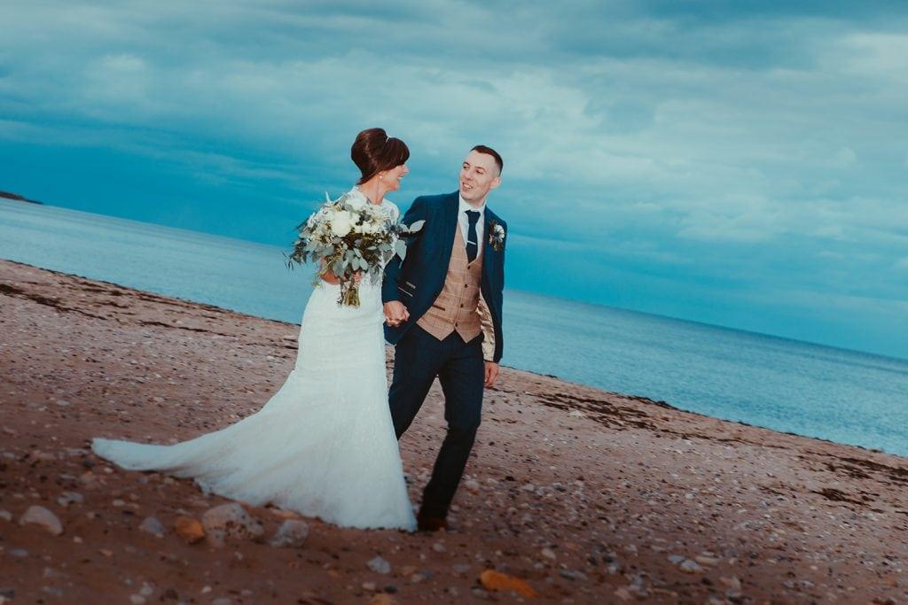 Bride & Groom walking on Sunderland Beach Front