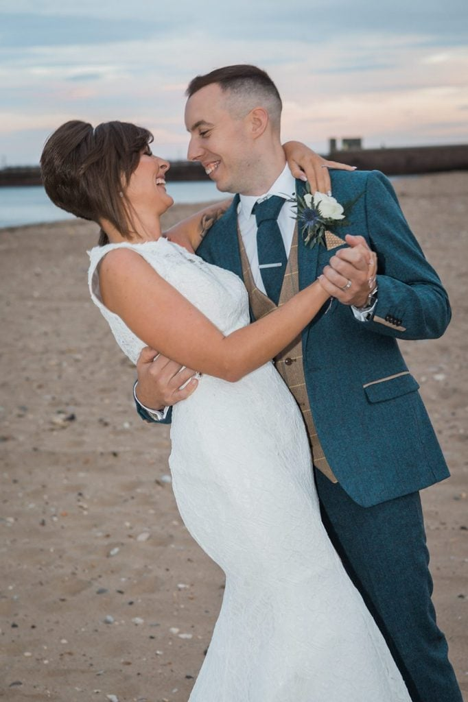 Bride & Groom dancing and smiling on Sunderland Beach Front