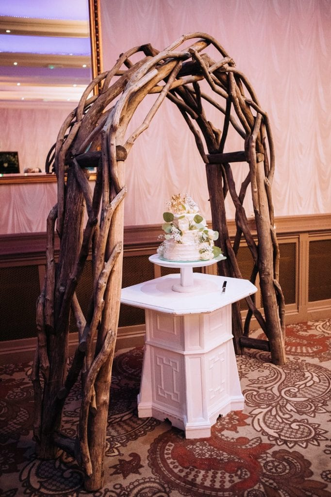 The wedding cake under a driftwood arche at The Roker Hotel in Sunderland