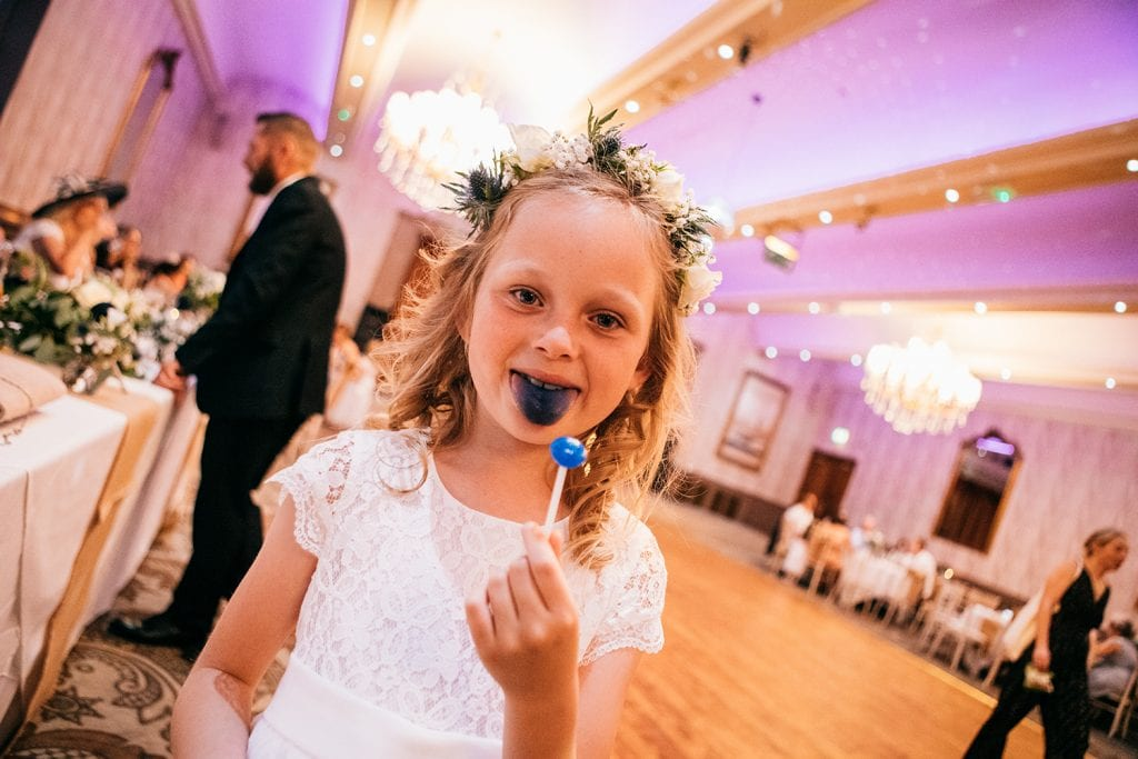 Flowergirl with a blue tongue and a lolly at The Roker Hotel in Sunderland