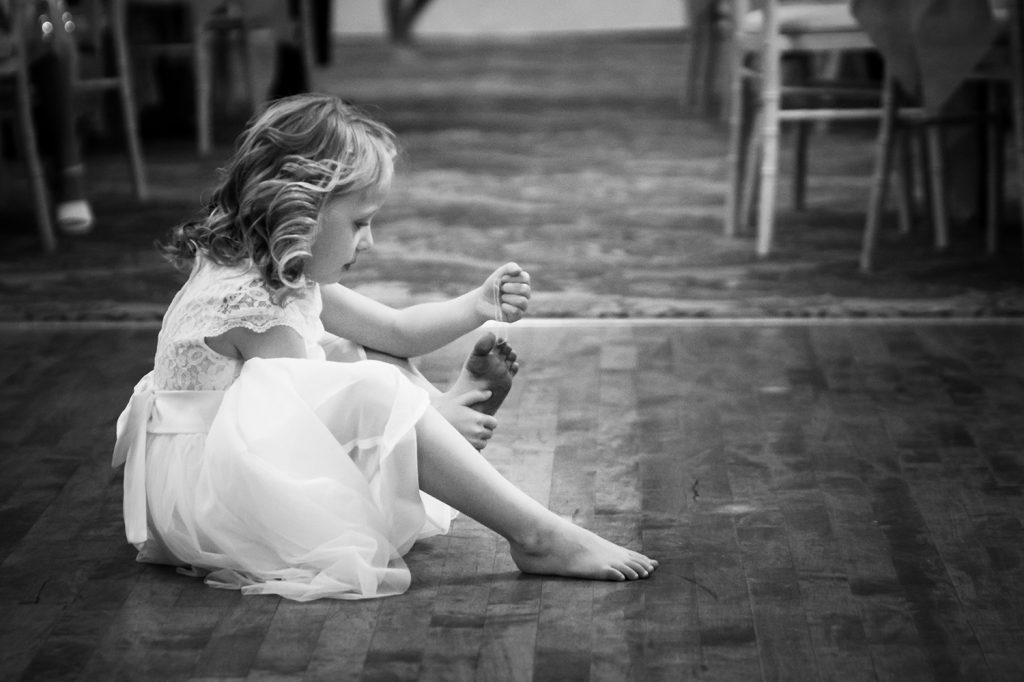 Flowergirl plying with her toes at The Roker Hotel in Sunderland