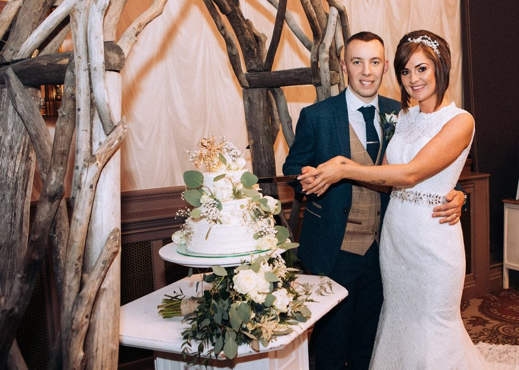 Bride & Groom cutting their cake at The Roker Hotel in Sunderland