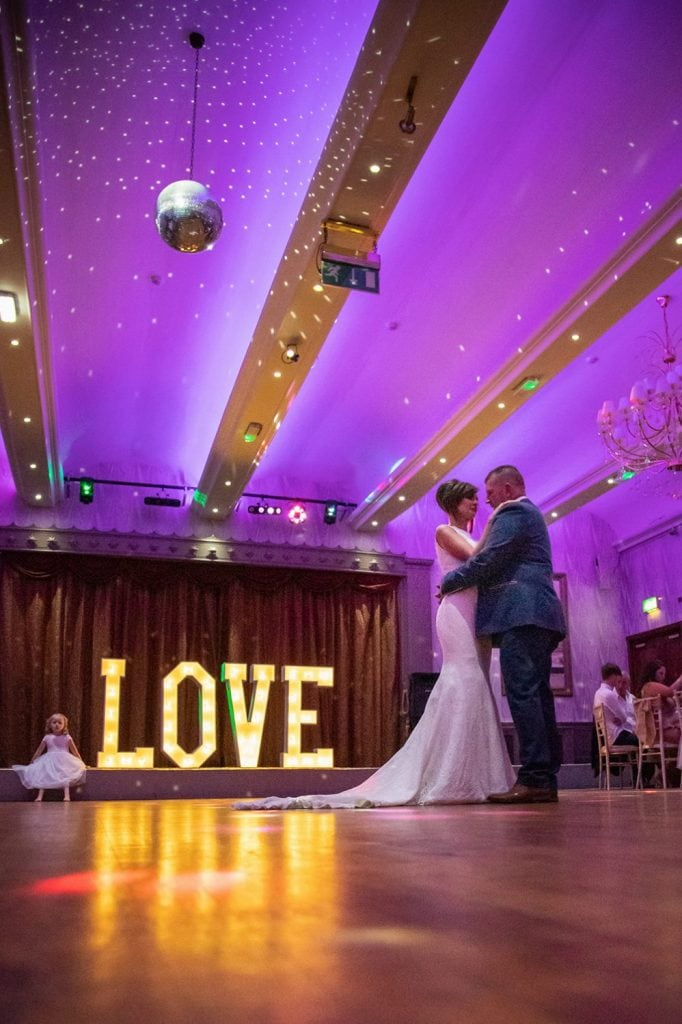 Low shot of Bride dancing with her dad at The Roker Hotel in Sunderland