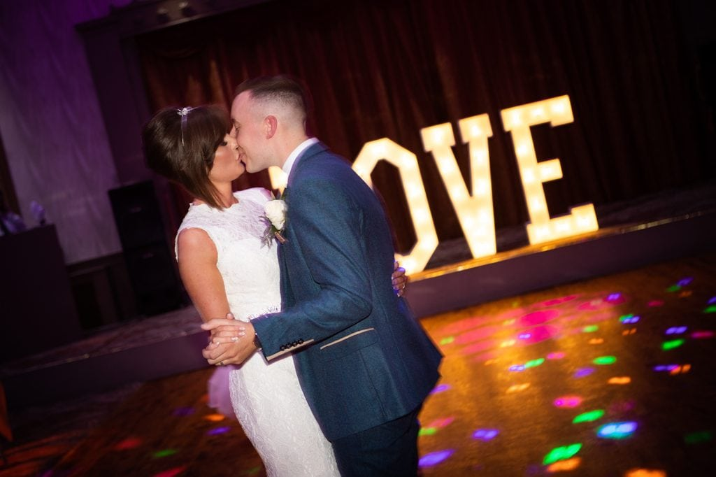 Bride & Groom kissing during first dance at The Roker Hotel in Sunderland