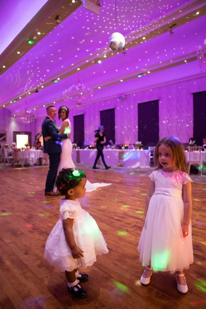 Flowergirl and toddler dancing with bride & Groom watching on at The Roker Hotel in Sunderland