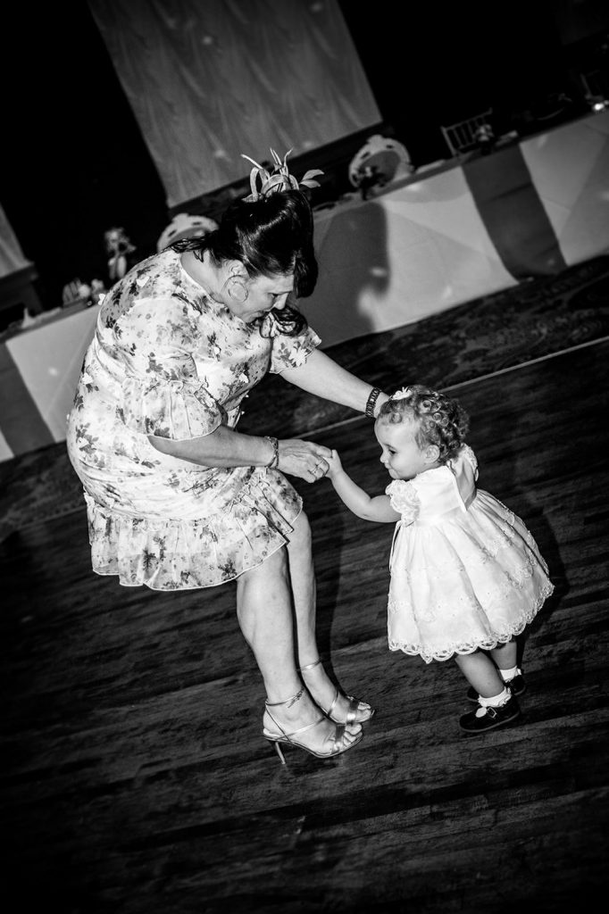 Wedding Guest dancing with toddler at The Roker Hotel in Sunderland