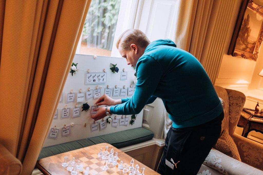 Groom creating a photo wall