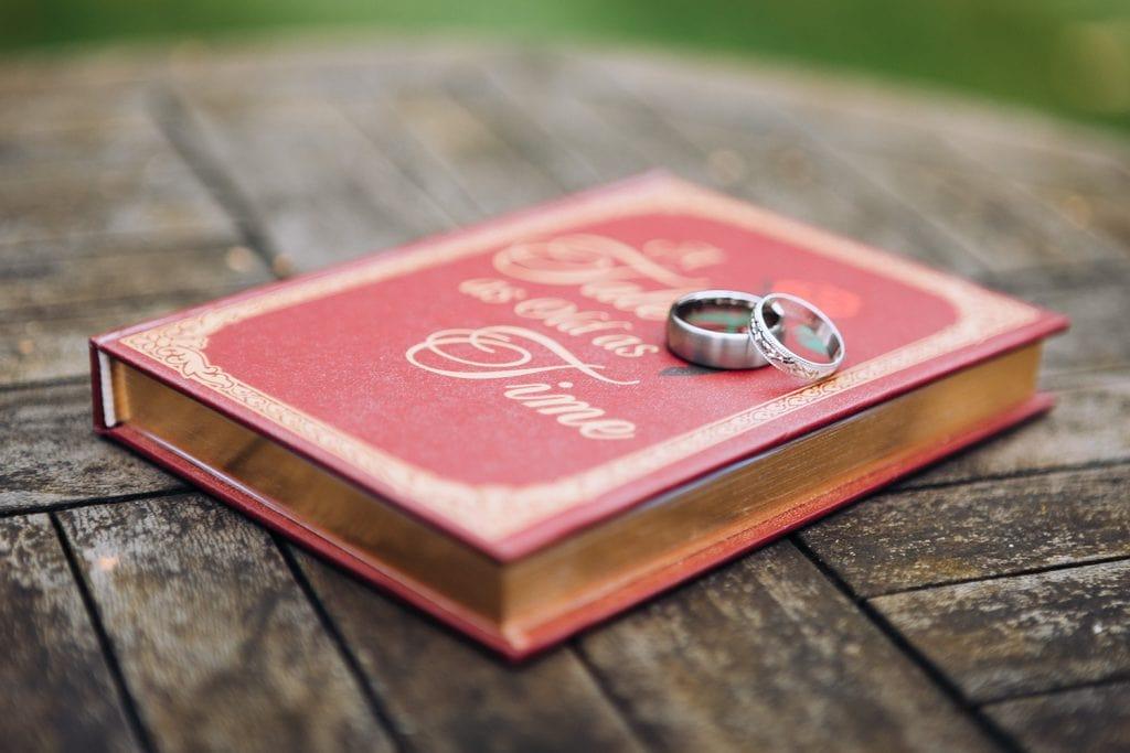 Wedding rings sitting on their case
