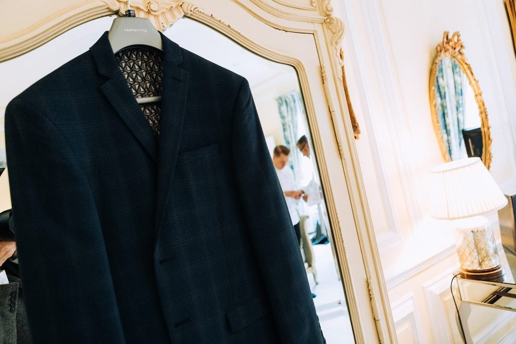 Grooms jacket hanging on a wardrode