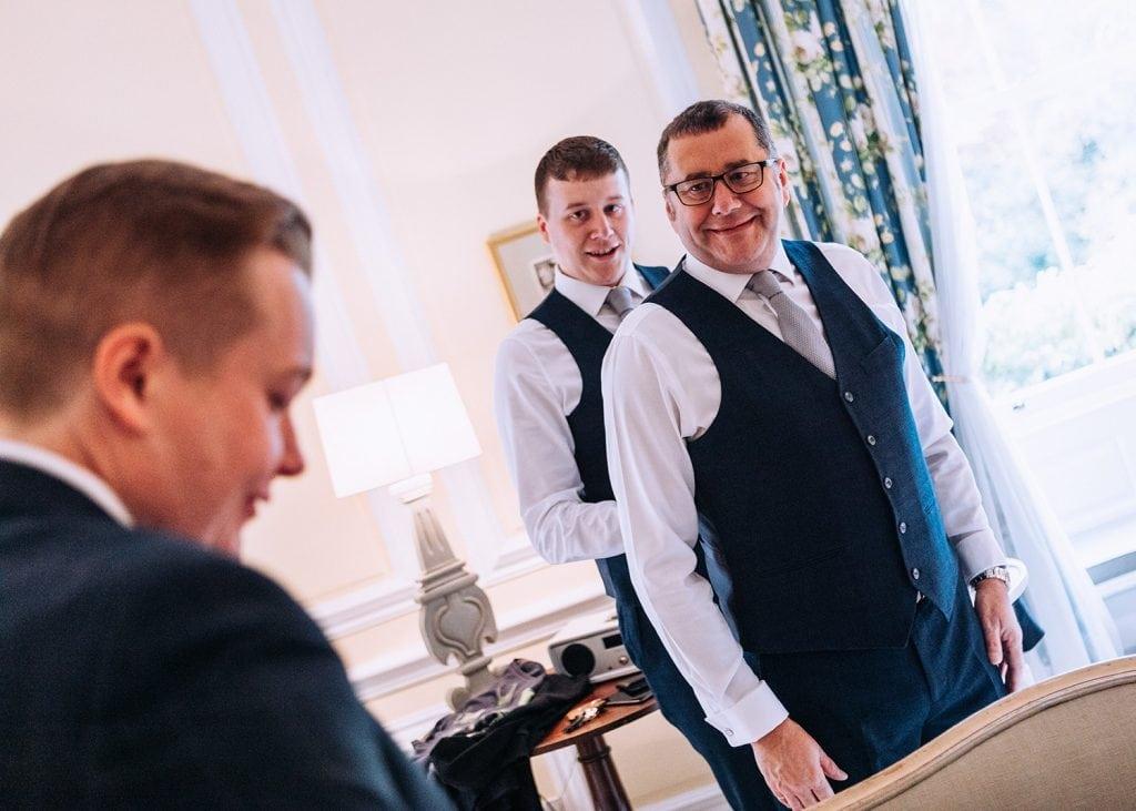 Groomsmen getting ready in their room at Eshott Hall in Northumberland
