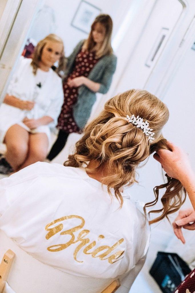 Bride having her hair styled